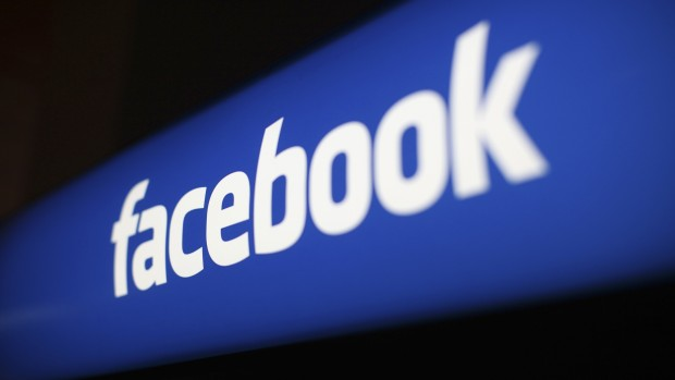 The Facebook logo is pictured at the Facebook headquarters in Menlo Park, California, in this January 29, 2013 file photo. Facebook Inc advertising business grew at its fastest clip since before the company's May initial public offering, helping the company's revenue expand 40 percent to .585 billion. REUTERS/Robert Galbraith/Files   (UNITED STATES - Tags: BUSINESS LOGO)
