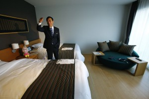 a-robotic-concierge-doll-is-also-located-in-each-room-to-help-guests-find-nearby-restaurants-and-recommend-events